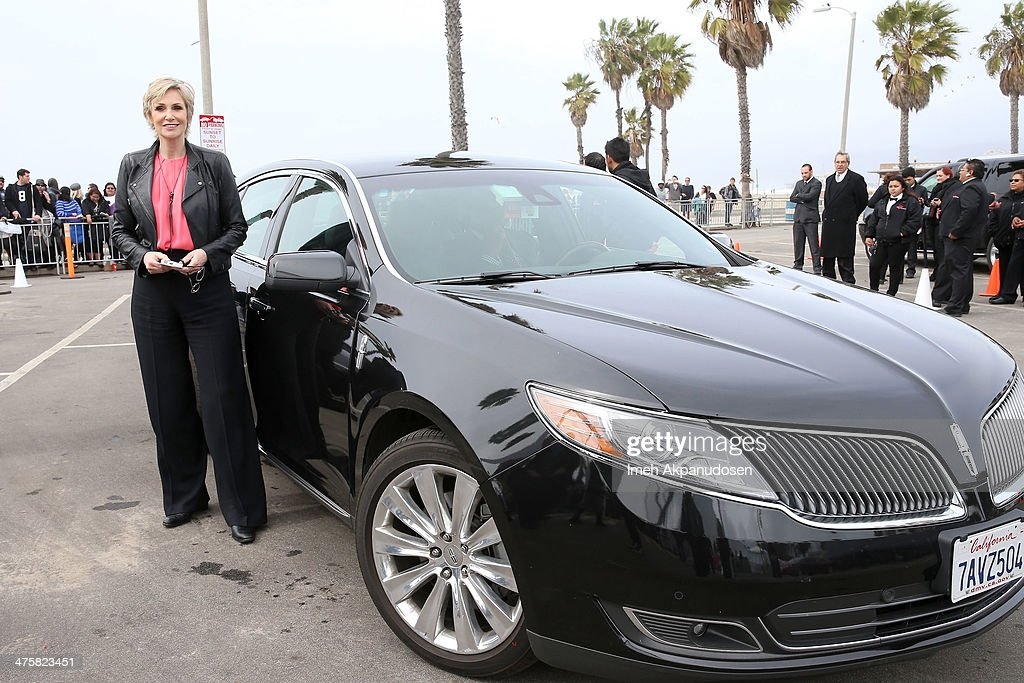 Actress Jane Lynch arrives in Lincoln's 2014 MKZ at 'Film Uncovered' presented by Lincoln Motor Company, honoring the Behind-The-Scenes Artisans of Independent Film, at the 2014 Film Independent Spirit Awards at Santa Monica Beach on March 1, 2014 in Santa Monica, California.