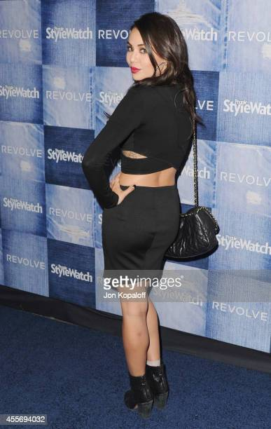 Actress Janel Parrish arrives at the People StyleWatch 4th Annual Denim Awards Issue at The Line on September 18 2014 in Los Angeles California