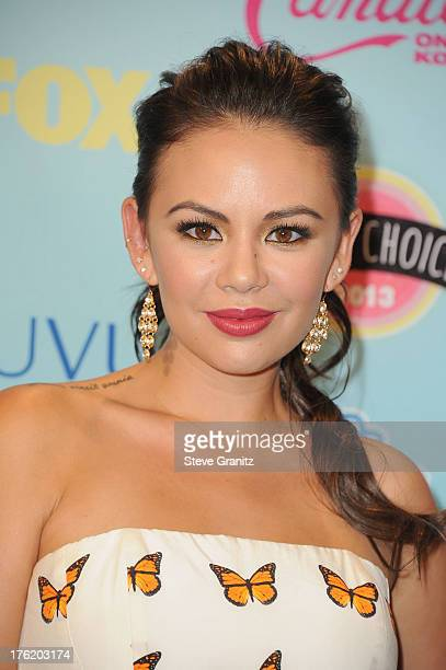 Actress Janel Parrish poses in the press room at the 2013 Teen Choice Awards at Gibson Amphitheatre on August 11 2013 in Universal City California