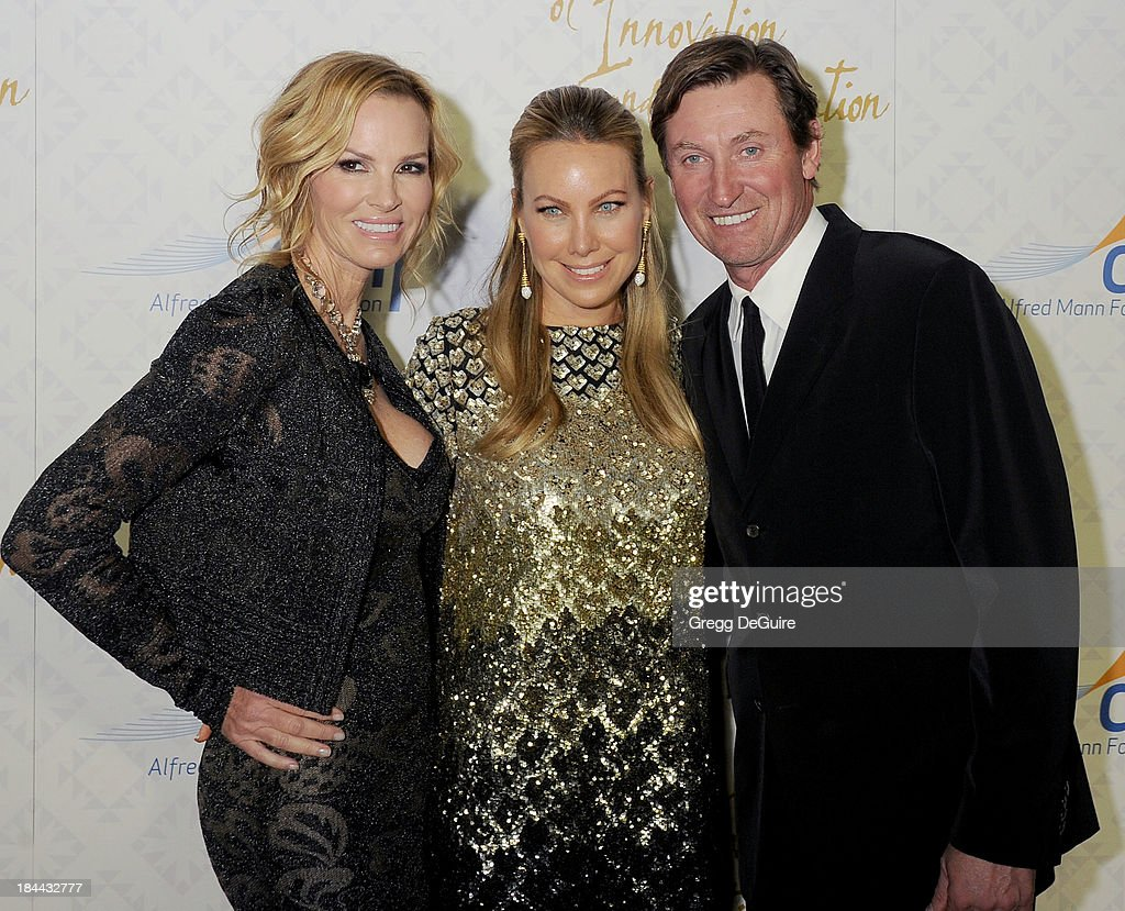 Actress Janet Jones Gretzky, Cassandra Mann and Wayne Gretzky attend the 10th Annual Alfred Mann Foundation Gala at 9900 Wilshire Blvd on October 13, 2013 in Beverly Hills, California.