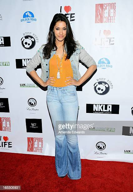Actress Janina Gavankar arrives at the No Kill LA Charity Event at Fred Segal on April 2 2013 in West Hollywood California