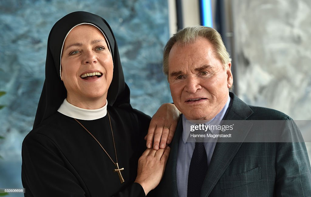 Actress Janina Hartwig and Fritz Wepper during a photocall for the tv show 'Um Himmels Willen' at Literaturhaus on May 24, 2016 in Munich, Germany.