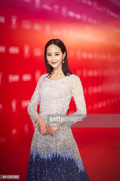 Actress Janine Chang arrives at the red carpet during the closing ceremony of 19th Shanghai International Film Festival at Shanghai Grand Theatre on...