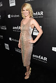 Actress January Jones attends amfAR LA Inspiration Gala honoring Tom Ford at Milk Studios on October 29 2014 in Hollywood California