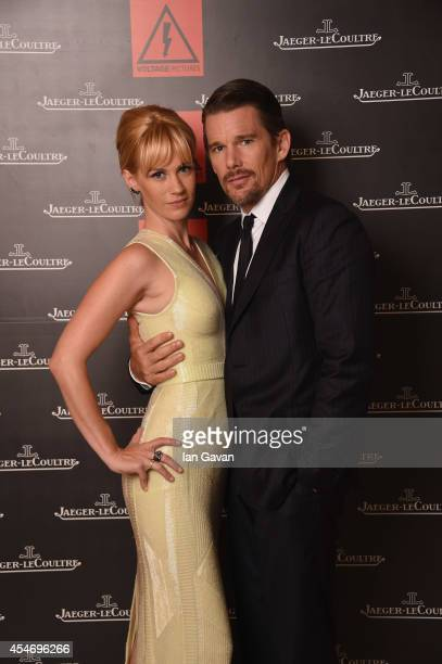 Actress January Jones wearing a JaegerLeCoultre watch and Ethan Hawke of 'Good Kill' pose for a portrait for JaegerLeCoultre in their festival lounge...