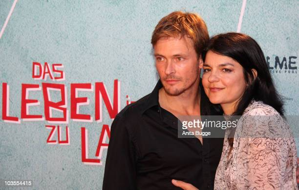 Actress Jasmin Tabatabai and Andreas Pietschmann attend the 'Das Leben Ist Zu Lang' Germany Premiere at the Kulturbrauerei movie theater on August 23...