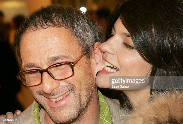 Actress Jasmin Tabatabai bites the ear of director Dani Levy at the Cinema for Peace Charity Gala on February 12 2007 in Berlin Germany The gala is...