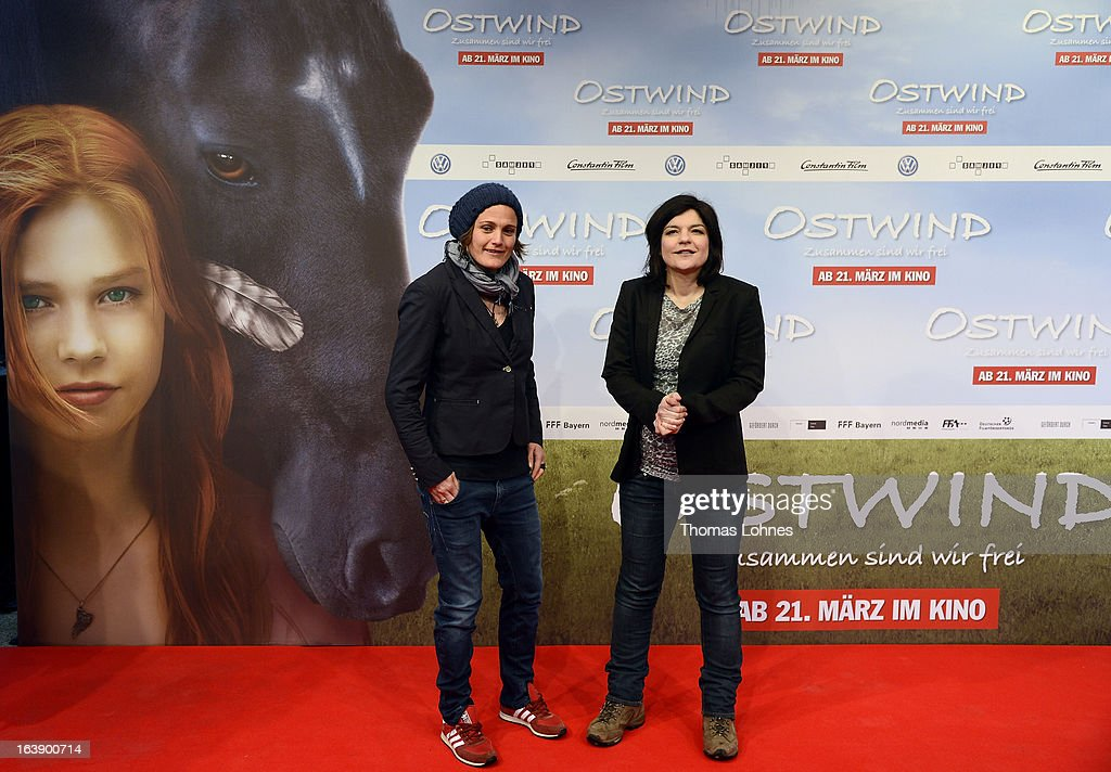Actress Jasmin Tabatabei (R) and the Goalkeeper of the German women's national soccer team, Nadine Angerer, attend the premiere of the film 'Ostwind' on March 17, 2013 in Frankfurt am Main, Germany. The family film portrays the friendship between the young Mika and the wild and shy stallion 'Ostwind' (east wind).