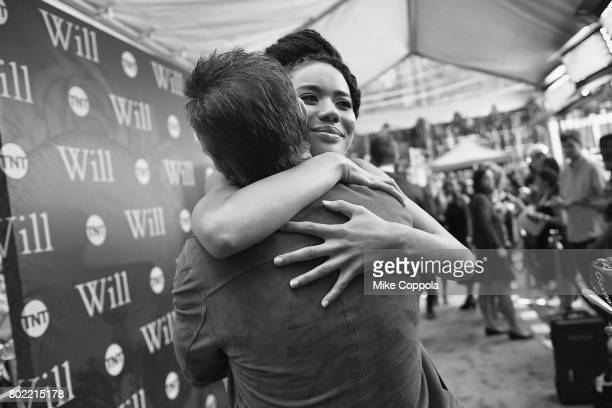 Actress Jasmine Savoy Brown hugs creator and executive producer Craig Pearce during TNT's Season One 'Will' Premiere at Bryant Park on June 27 2017...