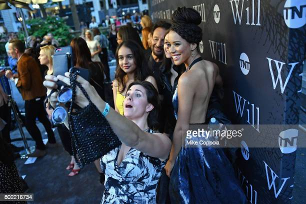 Actress Jasmine Savoy Brown poses for a selfie on the step and repeat during TNT's Season One 'Will' Premiere at Bryant Park on June 27 2017 in New...