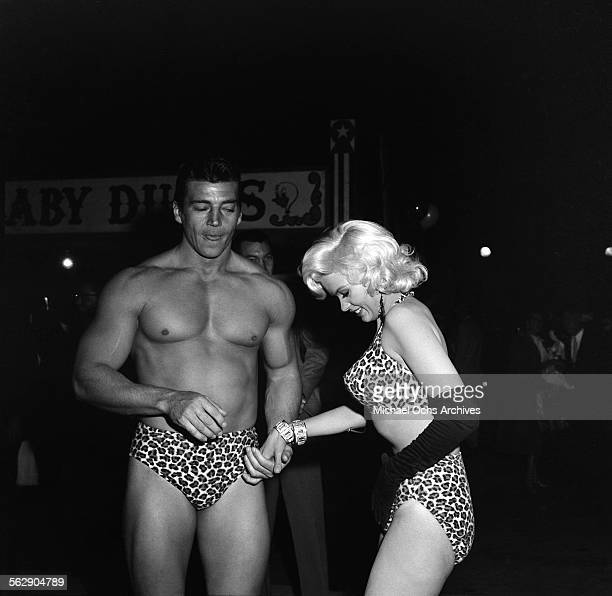 Actress Jayne Mansfield and Mickey Hargitay attend a Halloween party in Los AngelesCalifornia