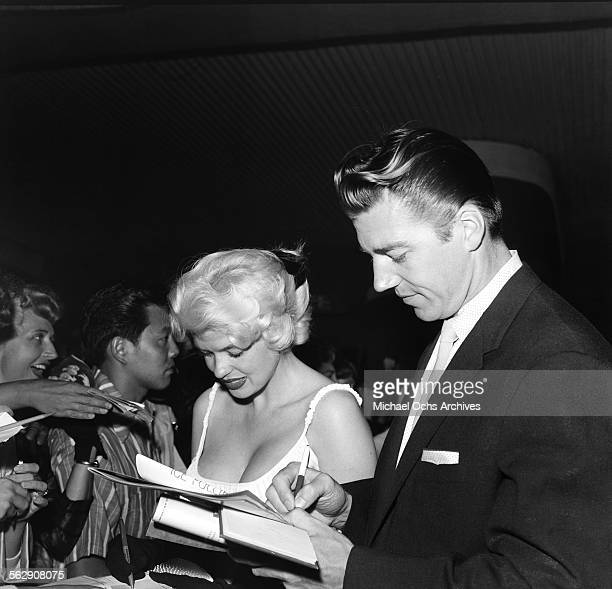 Actress Jayne Mansfield and Mickey Hargitay sign their autograph for fans as they attend an event in Los AngelesCalifornia