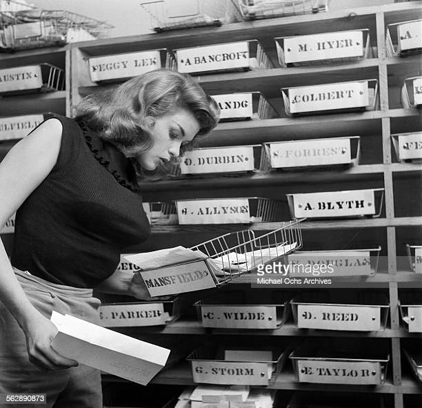 Actress Jayne Mansfield poses as she gets fan mail in Los AngelesCalifornia