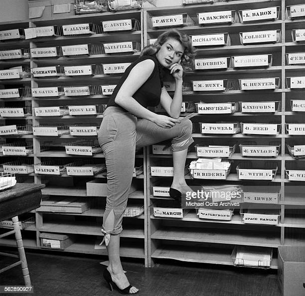 Actress Jayne Mansfield poses as she reads fan mail in Los AngelesCalifornia