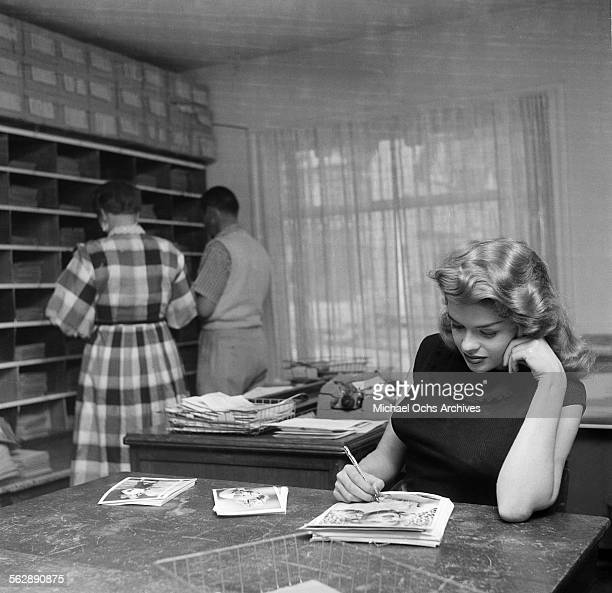 Actress Jayne Mansfield poses at the studio office in Los AngelesCalifornia