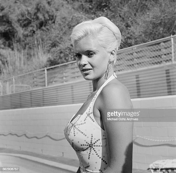 Actress Jayne Mansfield poses during a photo shoot by a pool in Los AngelesCalifornia