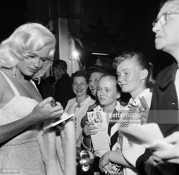 Actress Jayne Mansfield signs her autograph for young fans in Los AngelesCalifornia