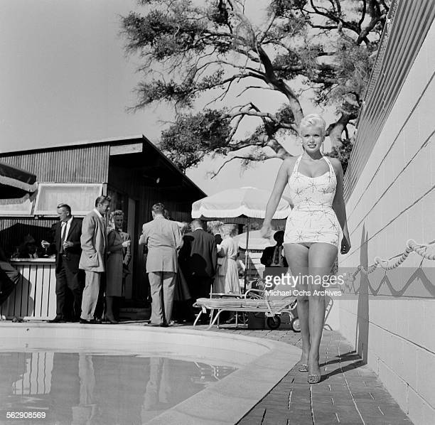 Actress Jayne Mansfield walks by the pool in Los AngelesCalifornia
