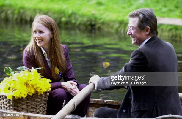Actress Jean Butler poses with daffodils in a rowing boat with actor John Hurt for the launch of Irish Cancer Society's Daffodil Day at the National...