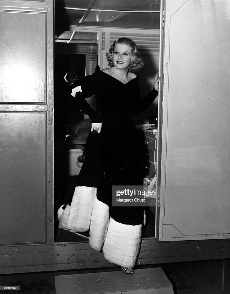 US actress Jean Harlow (1911 - 1937) at the door of her portable dressing-room on set during the filming of MGM's 'Personal Property'.