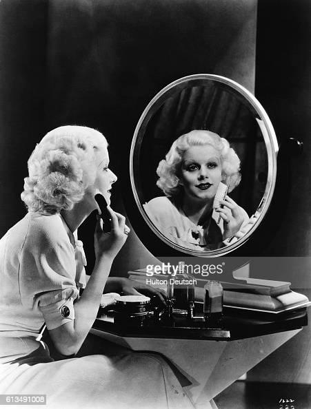 Actress Jean Harlow putting on her makeup ca 1930