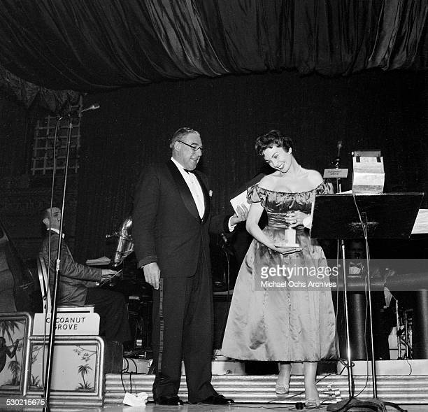 Actress Jean Simmons receives a Golden Globe Awards for Best Actress in 'Guys and Dolls' at the Cocoanut Grove in Los AngelesCA