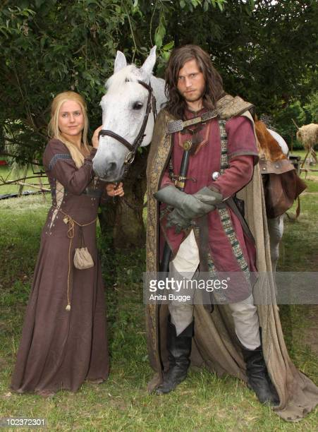 Actress Jeanette Biedermann and actor and Sebastian Stroebel pose for the press during a photocall for the historical drama TV production 'Isenhart'...