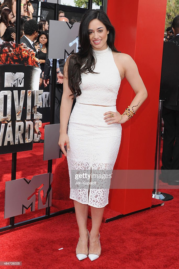 Actress Jeanine Mason arrives at the 2014 MTV Movie Awards at Nokia Theatre L.A. Live on April 13, 2014 in Los Angeles, California.