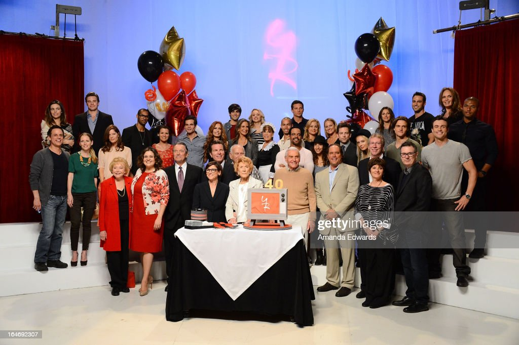 Actress <a gi-track='captionPersonalityLinkClicked' href=/galleries/search?phrase=Jeanne+Cooper&family=editorial&specificpeople=208646 ng-click='$event.stopPropagation()'>Jeanne Cooper</a> (front, center) poses along with the cast of the 'Young & The Restless' during the 'The Young & The Restless' 40th anniversary cake-cutting ceremony at CBS Television City on March 26, 2013 in Los Angeles, California.