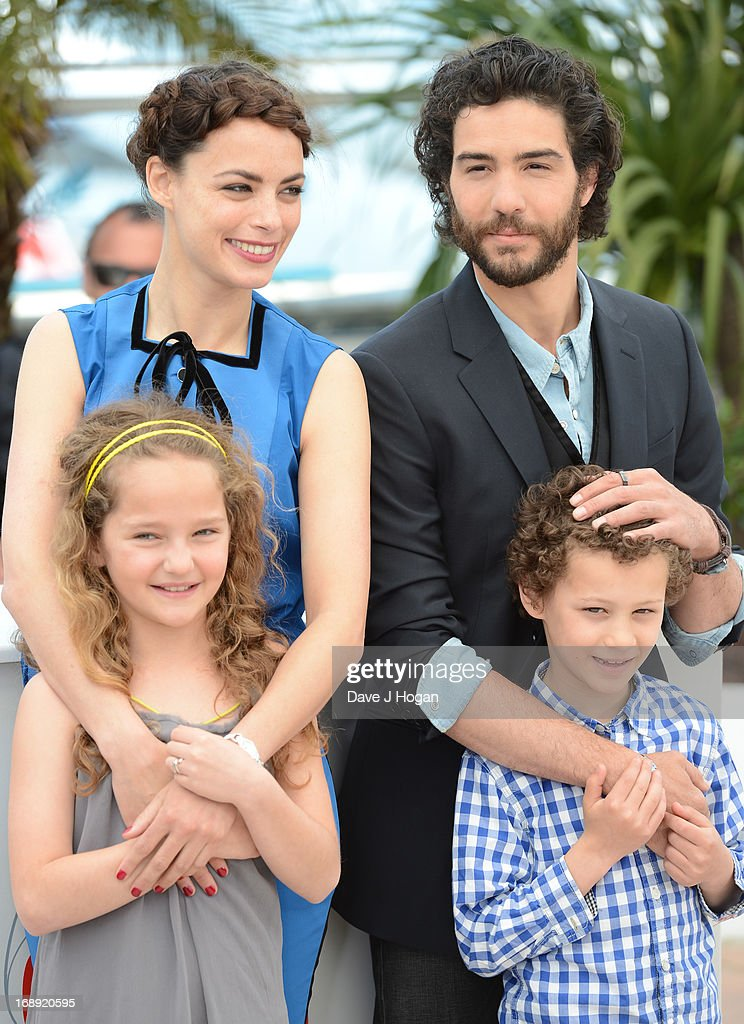 Actress Jeanne Jestin, actress Berenice Bejo, actor <a gi-track='captionPersonalityLinkClicked' href=/galleries/search?phrase=Tahar+Rahim&family=editorial&specificpeople=5856944 ng-click='$event.stopPropagation()'>Tahar Rahim</a> and actor Elyes Aguis attend 'Le Passe' photocall during the 66th Annual Cannes Film Festival at the Palais des Festivals on May 17, 2013 in Cannes, France.