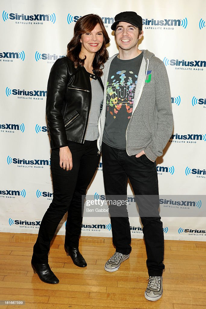 Actress Jeanne Tripplehorn (L) and Raw Dog host Mark Says Hi visit SiriusXM Studios on September 23, 2013 in New York City.