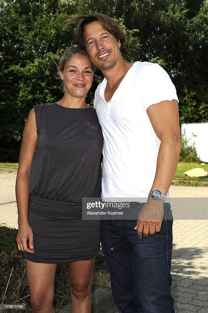 Actress Jelena Mitschke and actor Hakim Michael are beeing pictured during the 'Rote Rosen Fan-Tag 2013' on July 28, 2013 in Luneburg, Germany. More than 3500 fans of the daily television telenovela 'Rote Rosen' came to see the Studios and to meet their favorite actor.
