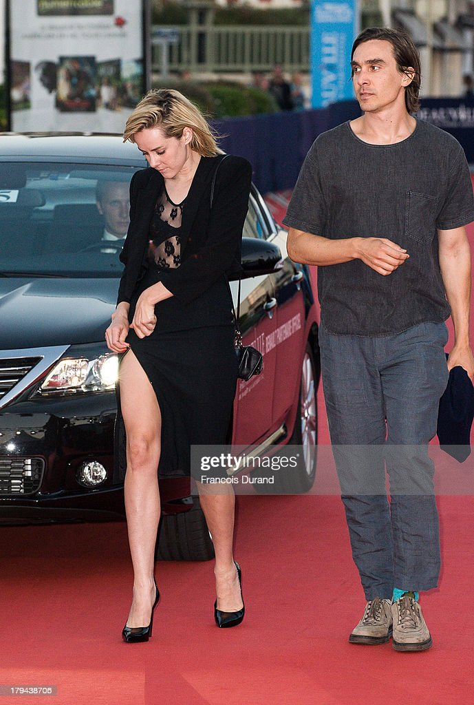 Actress <a gi-track='captionPersonalityLinkClicked' href=/galleries/search?phrase=Jena+Malone&family=editorial&specificpeople=216548 ng-click='$event.stopPropagation()'>Jena Malone</a> and director M Blash arrive at the premiere of the film 'Very Good Girls' during the 39th Deauville American Film Festival on September 3, 2013 in Deauville, France.