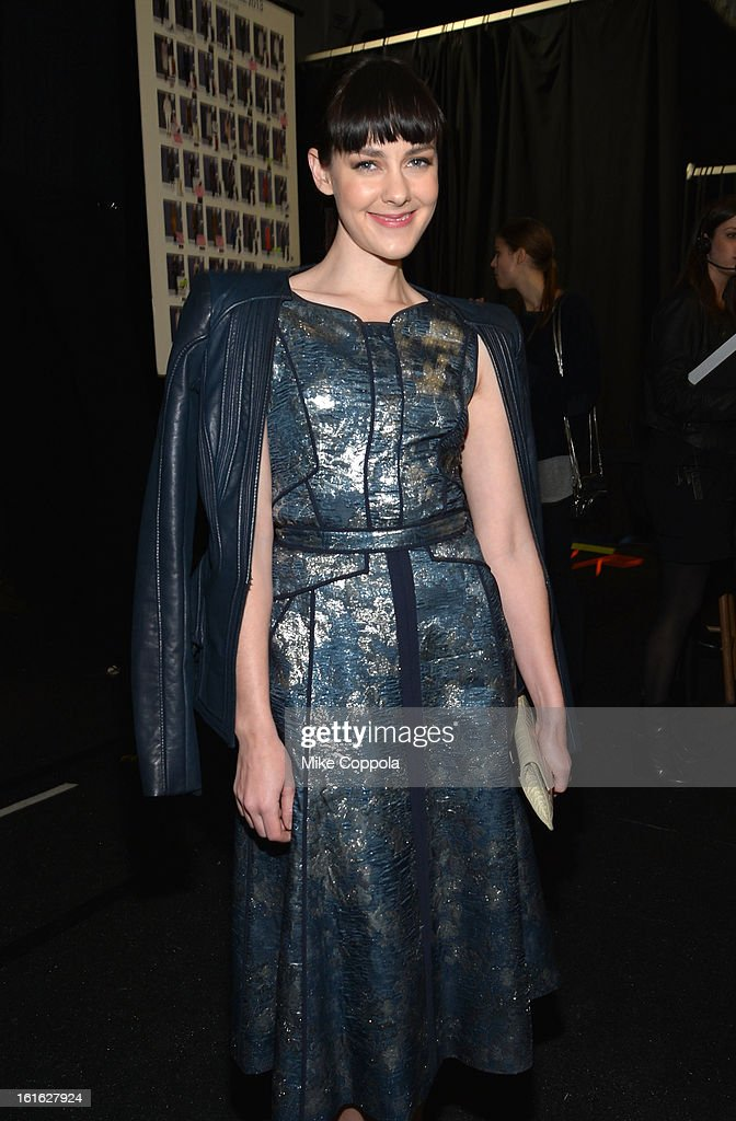 Actress Jena Malone poses backstage at the J. Mendel Fall 2013 fashion show during Mercedes-Benz Fashion Week at The Theatre at Lincoln Center on February 13, 2013 in New York City.