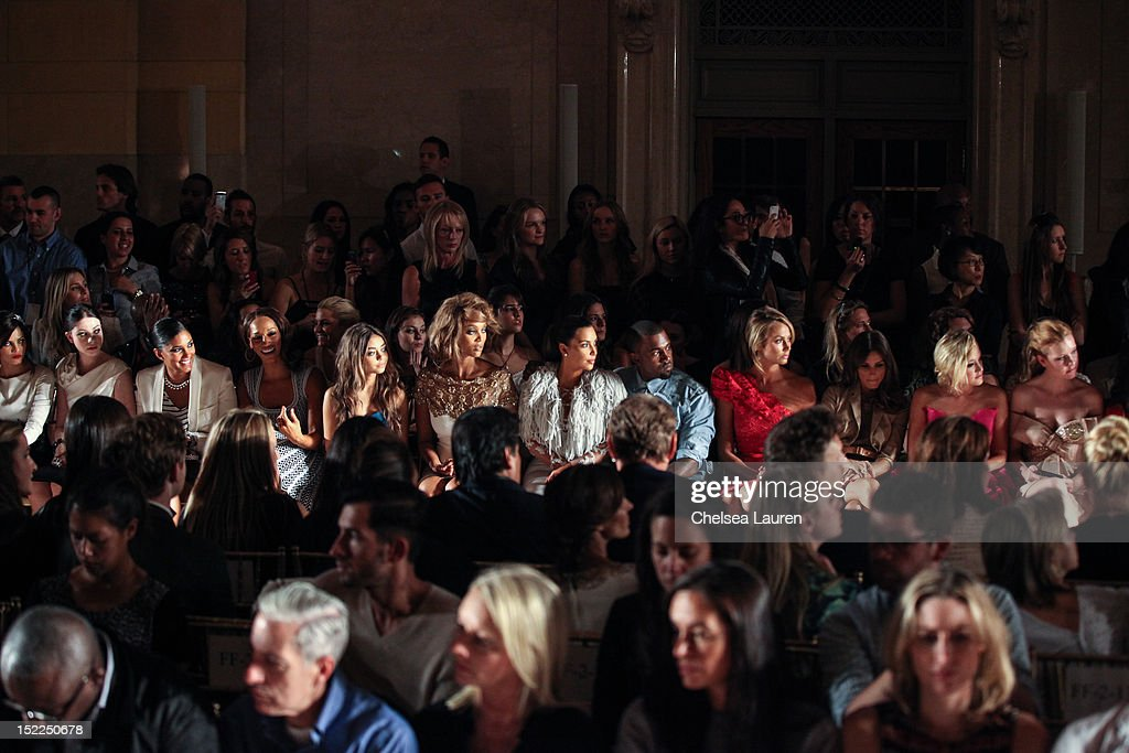 Actress Jenna Dewan, actress Michelle Trachtenberg, designer Rachel Roy, guest, actress Sarah Hyland, model Tyra Banks, television personality Kim Kardashian, vocalist Kanye West, actress Stacy Keibler and television personality Olivia Palermo attend the Marchesa spring 2013 fashion show during Mercedes-Benz Fashion Week at Vanderbilt Hall at Grand Central Terminal on September 12, 2012 in New York City.