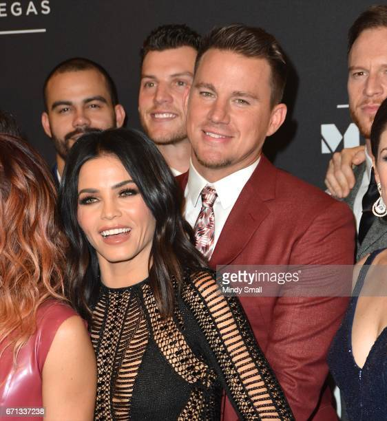 Actress Jenna DewanTatum and actor Channing Tatum pose with cast and creative team during the grand opening of 'Magic Mike Live Las Vegas' at the...
