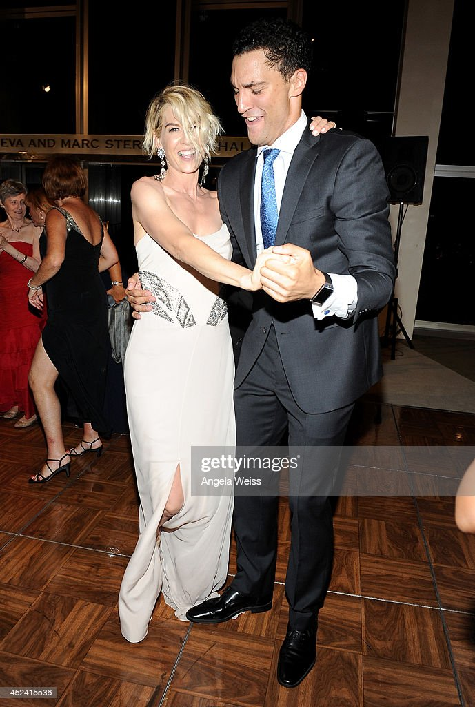 Actress <a gi-track='captionPersonalityLinkClicked' href=/galleries/search?phrase=Jenna+Elfman&family=editorial&specificpeople=204782 ng-click='$event.stopPropagation()'>Jenna Elfman</a> (L) and dancer Fabrice Calmels attend Dizzy Feet Foundation's Celebration Of Dance Gala at The Music Center on July 19, 2014 in Los Angeles, California.