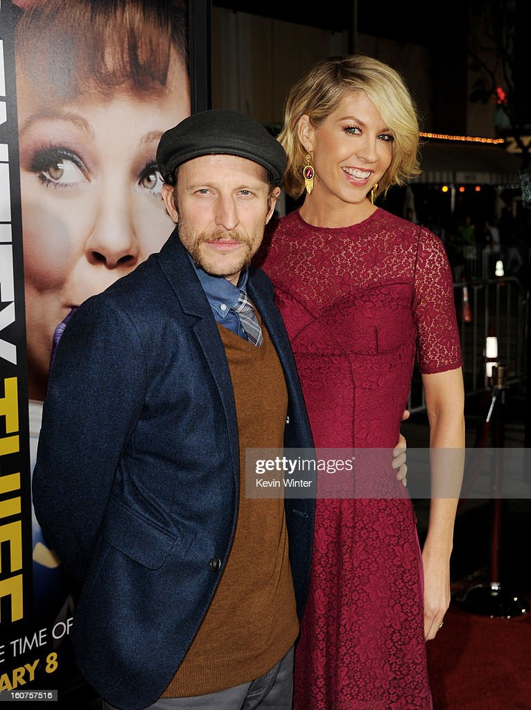 Actress Jenna Elfman (R) and her husband actor Bodhi Elfman arrive at the premiere of Universal Pictures' 'Identity Thief' at the Village Theatre on February 4, 2013 in Los Angeles, California.