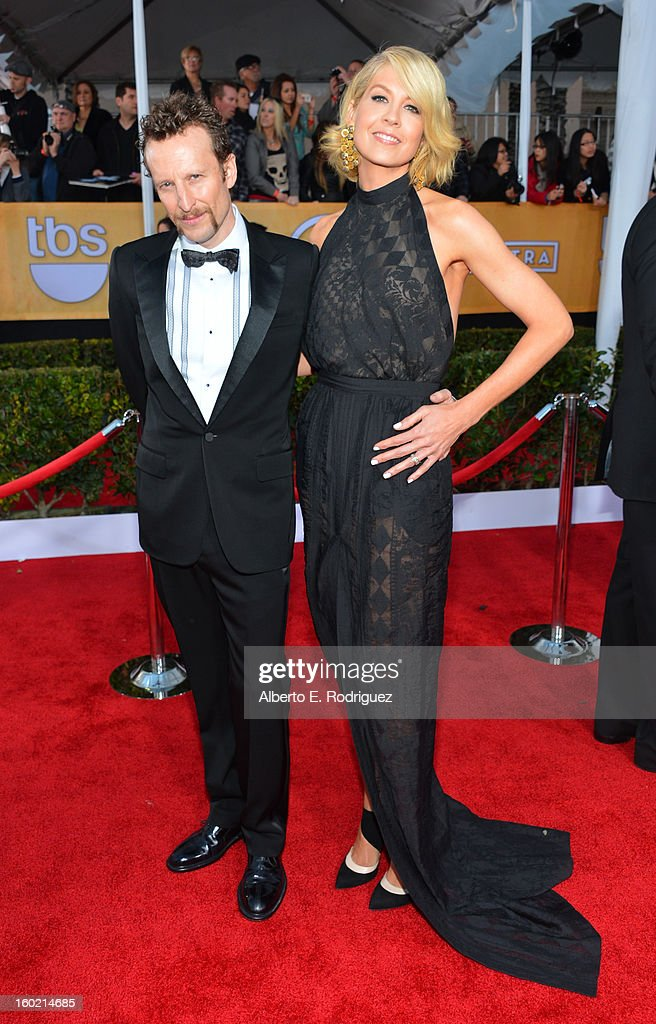 Actress Jenna Elfman (R) and husband Bodhi Elfman arrive at the 19th Annual Screen Actors Guild Awards held at The Shrine Auditorium on January 27, 2013 in Los Angeles, California.