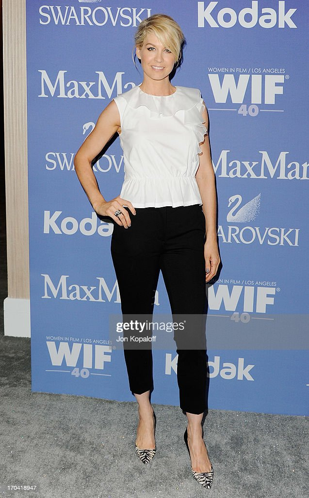Actress <a gi-track='captionPersonalityLinkClicked' href=/galleries/search?phrase=Jenna+Elfman&family=editorial&specificpeople=204782 ng-click='$event.stopPropagation()'>Jenna Elfman</a> arrives at the 2013 Women In Film's Crystal + Lucy Awards at The Beverly Hilton Hotel on June 12, 2013 in Beverly Hills, California.
