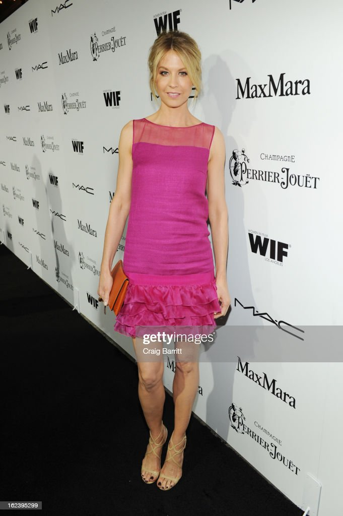 Actress Jenna Elfman attends the 6th Annual Women In Film Pre-Oscar Party hosted by Perrier Jouet, MAC Cosmetics and MaxMara at Fig & Olive on February 22, 2013 in Los Angeles, California.