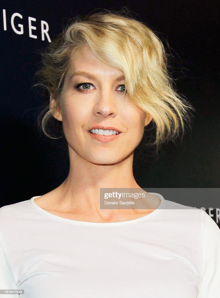 Actress Jenna Elfman attends Tommy Hilfiger New West Coast Flagship Opening on Robertson Boulevard on February 13, 2013 in West Hollywood, California.