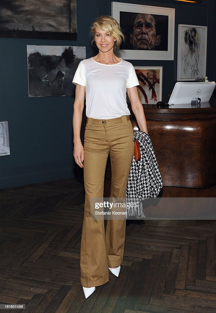 Actress Jenna Elfman attends Tommy Hilfiger New West Coast Flagship Opening After Party at a Private Club on February 13, 2013 in West Hollywood, California.