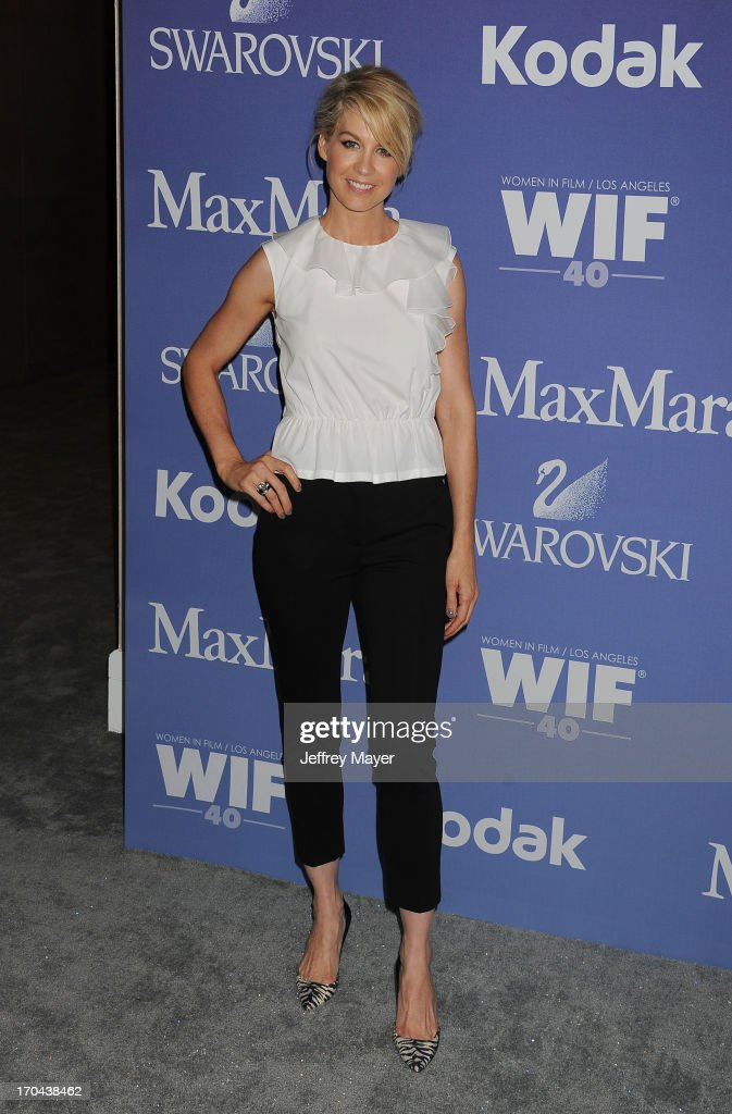 Actress <a gi-track='captionPersonalityLinkClicked' href=/galleries/search?phrase=Jenna+Elfman&family=editorial&specificpeople=204782 ng-click='$event.stopPropagation()'>Jenna Elfman</a> attends Women In Film's 2013 Crystal + Lucy Awards at The Beverly Hilton Hotel on June 12, 2013 in Beverly Hills, California.