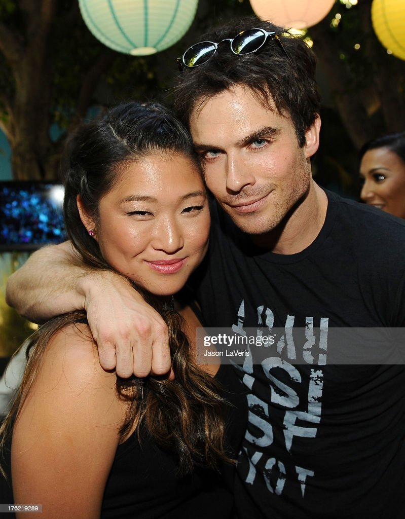 Actress Jenna Ushkowitz and actor Ian Somerhalder pose in the green room at the 2013 Teen Choice Awards at Gibson Amphitheatre on August 11, 2013 in Universal City, California.