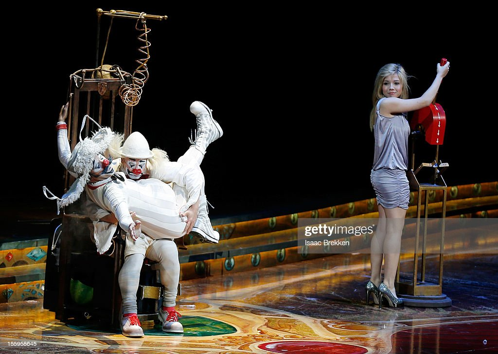 Actress Jennette McCurdy (R) makes a cameo on stage during the Las Vegas premiere of 'Zarkana by Cirque du Soleil' at the Aria Resort & Casino at CityCenter on November 9, 2012 in Las Vegas, Nevada.