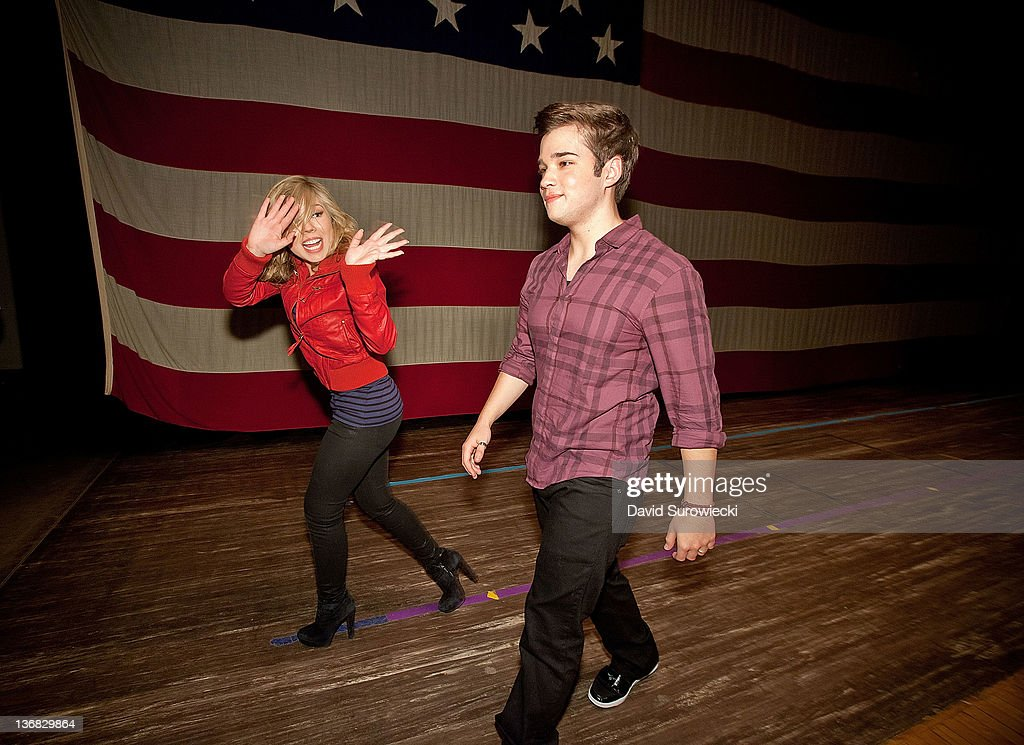 Actress Jennette McCurdy waves as she leaves the stage with Nathan Kress at Naval Submarine Base New London on January 11, 2012 in Groton, Connecticut. The cast of Nickelodeon's iCarly were presenting a special military family screening of iMeet The First Lady, an episode of their show featuring Michelle Obama.