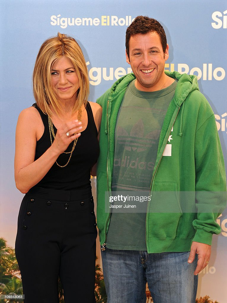 Actress Jennifer Aniston (L) and actor Adam Sandler attend a photo call to promote their new movie 'Just go with it' on February 22, 2011 in Madrid, Spain.