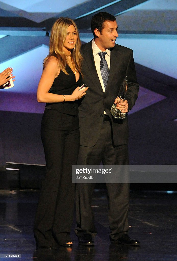 Actress <a gi-track='captionPersonalityLinkClicked' href=/galleries/search?phrase=Jennifer+Aniston&family=editorial&specificpeople=202048 ng-click='$event.stopPropagation()'>Jennifer Aniston</a> and actor <a gi-track='captionPersonalityLinkClicked' href=/galleries/search?phrase=Adam+Sandler&family=editorial&specificpeople=202205 ng-click='$event.stopPropagation()'>Adam Sandler</a> speak onstage during the 2011 People's Choice Awards at Nokia Theatre L.A. Live on January 5, 2011 in Los Angeles, California.
