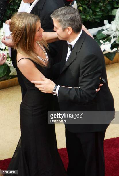 Actress Jennifer Aniston and actor George Clooney greet each other as they arrive at the 78th Annual Academy Awards at the Kodak Theatre March 5 2006...